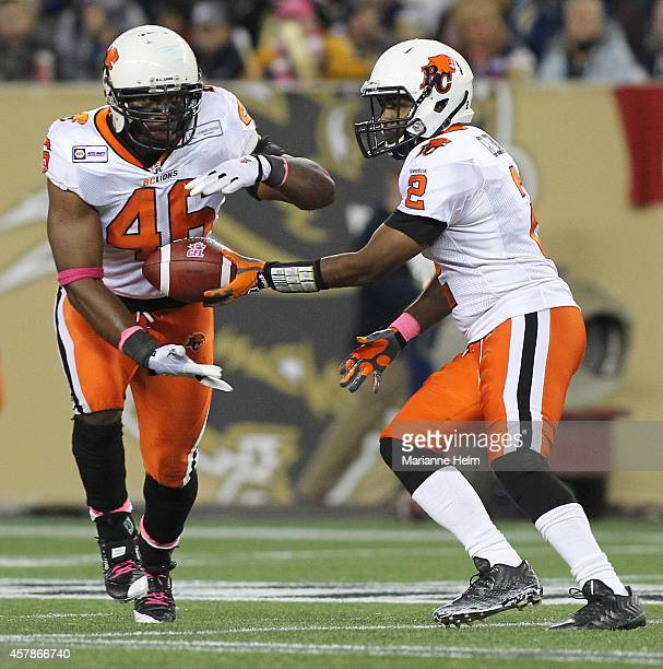 Kevin Glenn of the BC Lions hands off to Rolly Lumbala in second half action in a CFL game against the Winnipeg Blue Bombers at Investors Group Field...