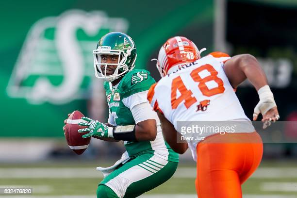 Kevin Glenn of the Saskatchewan Roughriders looks to pass before the rush of Maxx Forde of the BC Lions can reach him in the game between the BC...