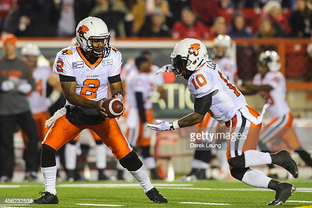 Kevin Glenn passes the ball of to Stefan Logan of the BC Lions during a CFL game at McMahon Stadium on September 27 2014 in Calgary Alberta Canada