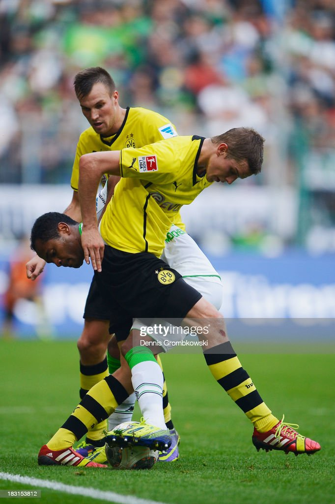 Kevin Gorsskreutz and <a gi-track='captionPersonalityLinkClicked' href=/galleries/search?phrase=Sven+Bender&family=editorial&specificpeople=596822 ng-click='$event.stopPropagation()'>Sven Bender</a> of Borussia Dortmund challenge Raffael of Borussia Moenchengladbach during the Bundesliga match between Borussia Moenchengladbach and Borussia Dortmund at Borussia-Park on October 5, 2013 in Moenchengladbach, Germany.