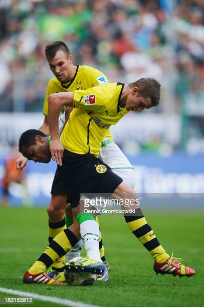 Kevin Gorsskreutz and Sven Bender of Borussia Dortmund challenge Raffael of Borussia Moenchengladbach during the Bundesliga match between Borussia...