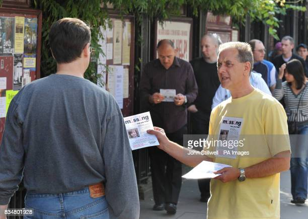 Kevin Gosden hands out leaflets showing his missing son Andrew outside St James Church before a service to mark the one year anniversary of his 14...