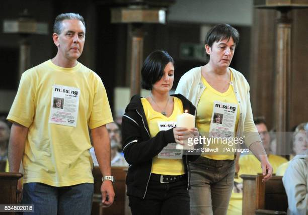 Kevin Gosden with daughter Charlotte and wife Glenys carry a candle to the Altar of St James Church in Piccadilly central London where a service to...