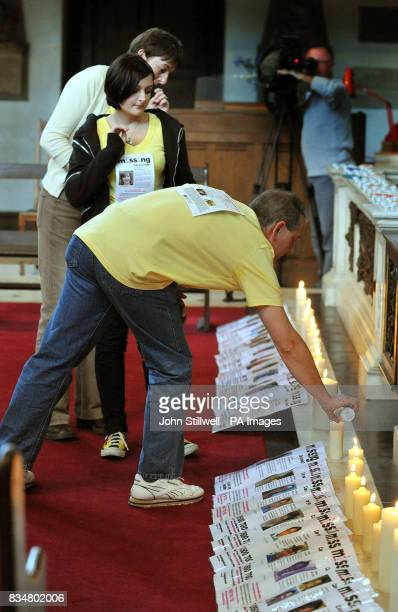 Kevin Gosden with daughter Charlotte and wife Glenys light a candle at the Altar of St James Church in Piccadilly central London where a service to...