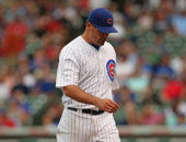 Kevin Gregg of the Chicago Cubs leaves the field after giving up 4 runs to the Atlanta Braves in the 9th inning at Wrigley Field on September 20 2013...