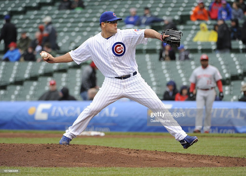 <a gi-track='captionPersonalityLinkClicked' href=/galleries/search?phrase=Kevin+Gregg&family=editorial&specificpeople=240417 ng-click='$event.stopPropagation()'>Kevin Gregg</a> #63 of the Chicago Cubs pitches against the Cincinnati Reds in the ninth inning on May 3, 2013 at Wrigley Field in Chicago, Illinois. The Reds defeated the Cubs 6-5.