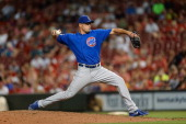 Kevin Gregg of the Chicago Cubs pitches against the Cincinnati Reds at Great American Ball Park on September 9 2013 in Cincinnati Ohio