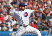 Kevin Gregg of the Chicago Cubs pitches in the 9th inning against the St Louis Cardinals at Wrigley Field on May 8 2013 in Chicago Illinois The...