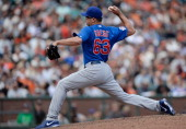 Kevin Gregg of the Chicago Cubs pitches in the ninth inning against the San Francisco Giants at ATT Park on July 28 2013 in San Francisco California...