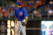 Kevin Gregg of the Chicago Cubs prepares to throw a pitch during the game against the Philadelphia Phillies at Citizens Bank Park on August 7 2013 in...