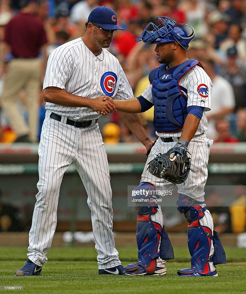 Kevin Gregg #63 of the Chicago Cubs (L) shakes hands with Welington Castillo #53 after a win against the Pittsburgh Pirates at Wrigley Field on July 6, 2013 in Chicago, Illinois. The Cubs defeated the Pirates 4-1.