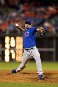 Kevin Gregg of the Chicago Cubs throws a pitch during the game against the Philadelphia Phillies at Citizens Bank Park on August 7 2013 in...