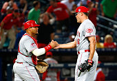 Kevin Gregg of the Cincinnati Reds shakes hands with Brayan Pena after their 84 win over the Atlanta Braves at Turner Field on May 2 2015 in Atlanta...
