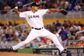 Kevin Gregg of the Miami Marlins of the Miami Marlins pitches during the eighth inning of the game against the New York Mets at Marlins Park on June...
