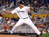 Kevin Gregg of the Miami Marlins pitches during the ninth inning of the game against the New York Mets at Marlins Park on June 19 2014 in Miami...