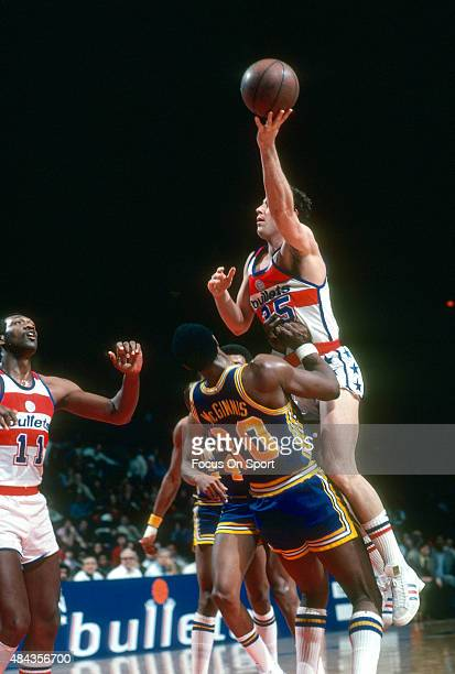 Kevin Grevey of the Washington Bullets shoots over George McGinnis of the Indiana Pacers during an NBA basketball game circa 1980 at the Capital...