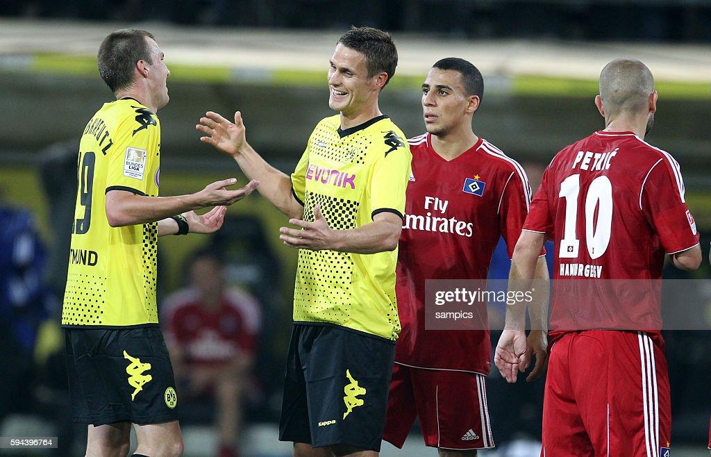 Kevin Großkreutz und Sebastian Kehl freuen sich uber den Sieg rechts die enttäuschten Hamburger Ben Hatira und Mladen Petric Fussball 1 Bundesliga...