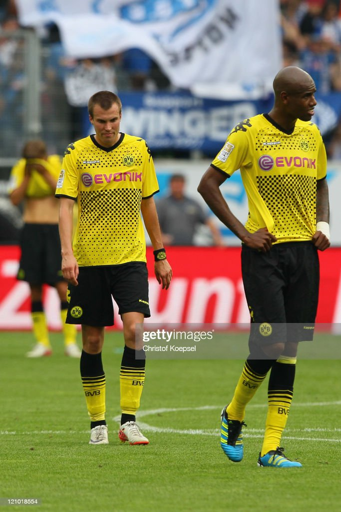 <a gi-track='captionPersonalityLinkClicked' href=/galleries/search?phrase=Kevin+Grosskreutz&family=editorial&specificpeople=4265546 ng-click='$event.stopPropagation()'>Kevin Grosskreutz</a> and <a gi-track='captionPersonalityLinkClicked' href=/galleries/search?phrase=Felipe+Santana&family=editorial&specificpeople=5422021 ng-click='$event.stopPropagation()'>Felipe Santana</a> of Dortmund look dejectedafter losing 0-1 the Bundesliga macht between TSG 1899 Hoffenheim and Borussia Dortmund at Wirsol Rhein-Neckar Arena on August 13, 2011 in Sinsheim, Germany.