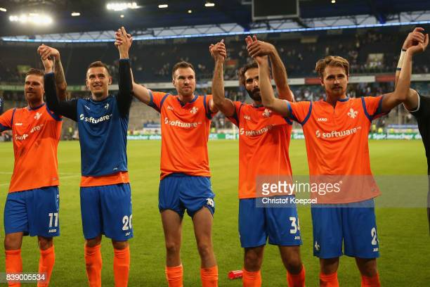 Kevin Grosskreutz and Hamit Altintop of Darmstadt and theier team mates celebrate after winning the Second Bundesliga match between MSV Duisburg and...