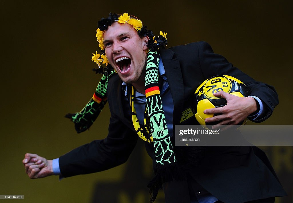 Kevin Grosskreutz celebrates on the stage during the Borussia Dortmund Bundesliga winners parade at Westfalenhalle on May 15, 2011 in Dortmund, Germany.