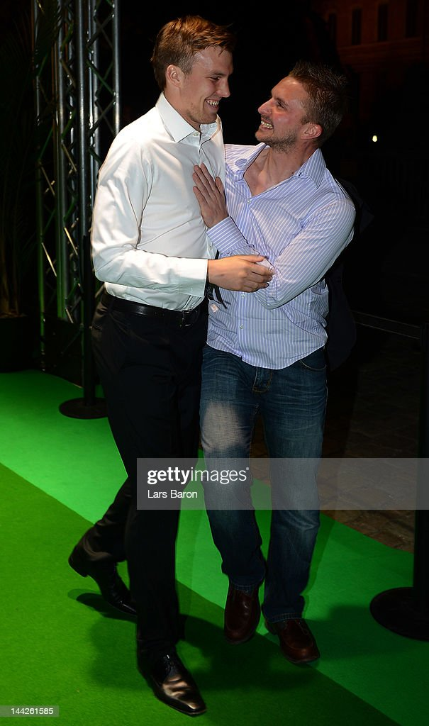 Kevin Grosskreutz celebrates with a friend during the Borussia Dortmund party at the Ewerk on May 13, 2012 in Berlin, Germany.