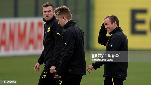 Kevin Grosskreutz Marco Reus and Mario Goetze warm up during a Borussia Dortmund training session ahead of their UEFA Champions League Semi Final...