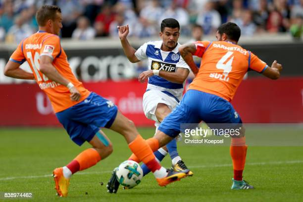Kevin Grosskreutz of Darmstadt and Aytac Sulu of Darmstadt challenge Pauly Oliveira Souza of Duisburg during the Second Bundesliga match between MSV...