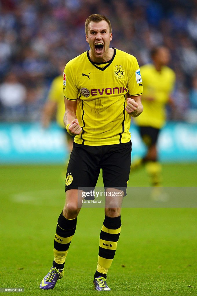 <a gi-track='captionPersonalityLinkClicked' href=/galleries/search?phrase=Kevin+Grosskreutz&family=editorial&specificpeople=4265546 ng-click='$event.stopPropagation()'>Kevin Grosskreutz</a> of Dortmund celebrates after Nuri Sahin scored the second goal during the Bundesliga match between FC Schalke 04 and Borussia Dortmund at Veltins-Arena on October 26, 2013 in Gelsenkirchen, Germany.