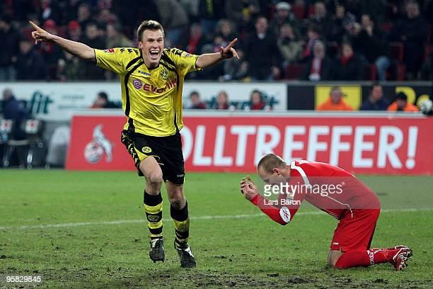 Kevin Grosskreutz of Dortmund celebrates after scoring the winning goal next to Kevin McKenna of Koeln during the Bundesliga match between 1 FC Koeln...