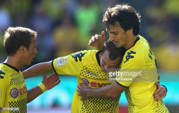 Kevin Grosskreutz of Dortmund celebrates the second goal qith Mario Goetze and Mats Hummels during the Bundesliga match between Borussia Dortmund and...