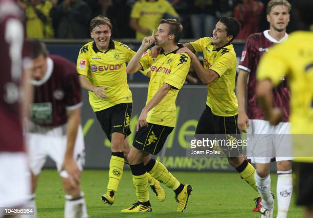 Kevin Grosskreutz of Dortmund celebrates with his team mates after scoring his team's second goal during the Bundesliga match between Borussia...