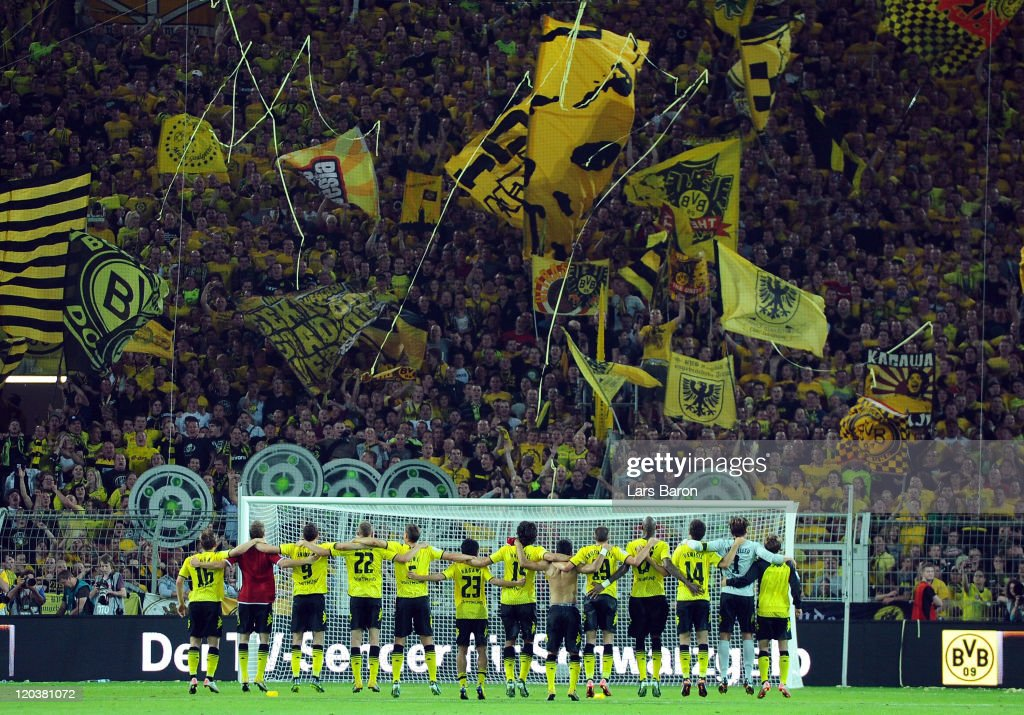 Kevin Grosskreutz of Dortmund celebrates with his team mates and the fans after winning the Bundesliga match between Borussia Dortmund and Hamburger...