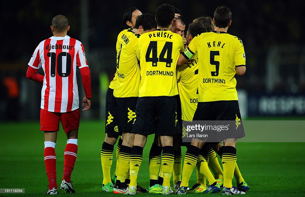 <a gi-track='captionPersonalityLinkClicked' href=/galleries/search?phrase=Kevin+Grosskreutz&family=editorial&specificpeople=4265546 ng-click='$event.stopPropagation()'>Kevin Grosskreutz</a> of Dortmund celebrates with team mates next to <a gi-track='captionPersonalityLinkClicked' href=/galleries/search?phrase=Rafik+Djebbour&family=editorial&specificpeople=4509033 ng-click='$event.stopPropagation()'>Rafik Djebbour</a> of Olympiacos after scoring his teams first goal during the UEFA Champions League group F match between Borussia Dortmund and Olympiacos FC at Signal Iduna Park on November 1, 2011 in Dortmund, Germany.