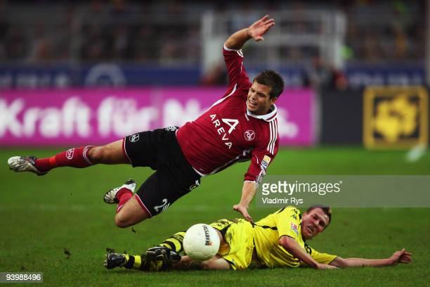 Kevin Grosskreutz of Dortmund fouls Dennis Diekmeier of Nuernberg during the Bundesliga match between Borussia Dortmund and 1 FC Nuernberg at Signal...