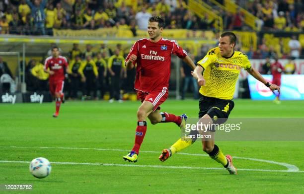 Kevin Grosskreutz of Dortmund scores his teams first goal during the Bundesliga match between Borussia Dortmund and Hamburger SV at Signal Iduna Park...