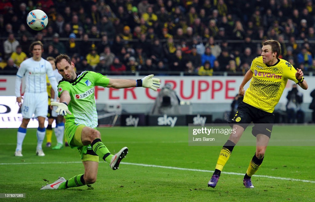 <a gi-track='captionPersonalityLinkClicked' href=/galleries/search?phrase=Kevin+Grosskreutz&family=editorial&specificpeople=4265546 ng-click='$event.stopPropagation()'>Kevin Grosskreutz</a> of Dortmund scores his teams second goal past goalkeeper Tom Starke of Hoffenheim during the Bundesliga match between Borussia Dortmund and 1899 Hoffenheim at Signal Iduna Park on January 28, 2012 in Dortmund, Germany.