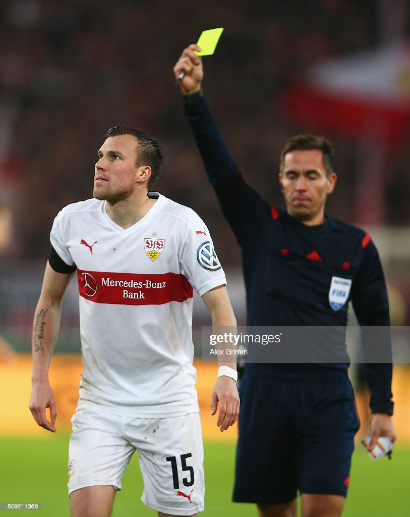 Kevin Grosskreutz of Stuttgart is shown a yellow card by referee Tobias Stieler during the DFB Cup Quarter Final match between VfB Stuttgart and Borussia Dortmund at Mercedes-Benz Arena on February 9, 2016 in Stuttgart, Germany.