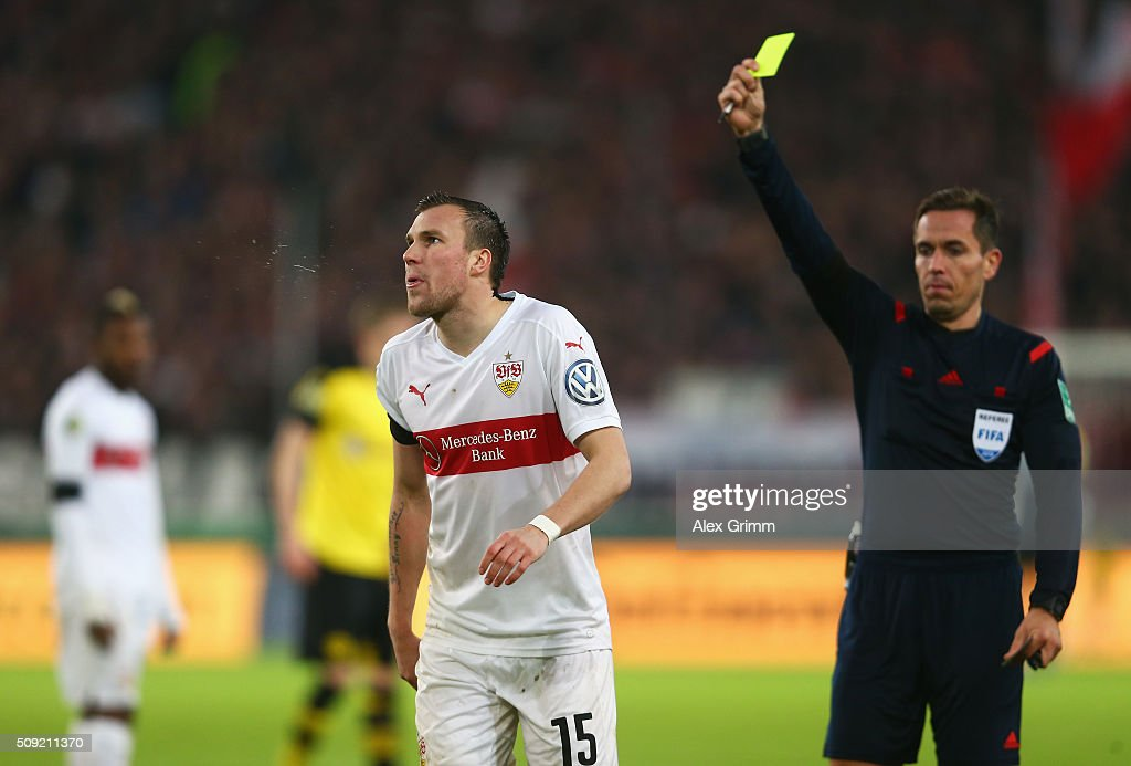 <a gi-track='captionPersonalityLinkClicked' href=/galleries/search?phrase=Kevin+Grosskreutz&family=editorial&specificpeople=4265546 ng-click='$event.stopPropagation()'>Kevin Grosskreutz</a> of Stuttgart is shown a yellow card by referee Tobias Stieler during the DFB Cup Quarter Final match between VfB Stuttgart and Borussia Dortmund at Mercedes-Benz Arena on February 9, 2016 in Stuttgart, Germany.