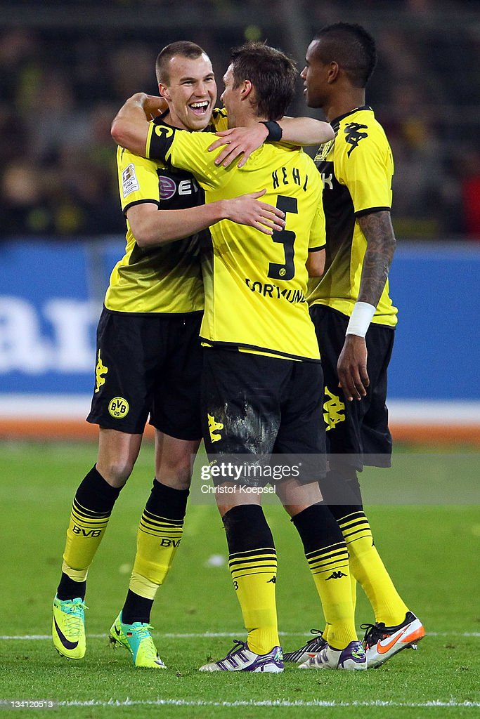 <a gi-track='captionPersonalityLinkClicked' href=/galleries/search?phrase=Kevin+Grosskreutz&family=editorial&specificpeople=4265546 ng-click='$event.stopPropagation()'>Kevin Grosskreutz</a>, <a gi-track='captionPersonalityLinkClicked' href=/galleries/search?phrase=Sebastian+Kehl&family=editorial&specificpeople=486611 ng-click='$event.stopPropagation()'>Sebastian Kehl</a> and <a gi-track='captionPersonalityLinkClicked' href=/galleries/search?phrase=Felipe+Santana&family=editorial&specificpeople=5422021 ng-click='$event.stopPropagation()'>Felipe Santana</a> of Dortmund celebrate the 2-0 victory after the Bundesliga match between Borussia Dortmund and FC Schalke 04 at Signal Iduna Park on November 26, 2011 in Dortmund, Germany.