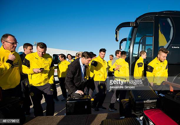 Kevin Grosskreutz sport director Michael Zorc and Ciro Immobile of Borussia Dortmund at the airport during the journey to the training ground on...