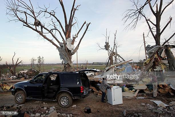 Kevin Hancock recovers a friend's clothes washing machine from a destroyed mobile home April 4 2006 in Marmaduke Arkansas Nearly half of the...