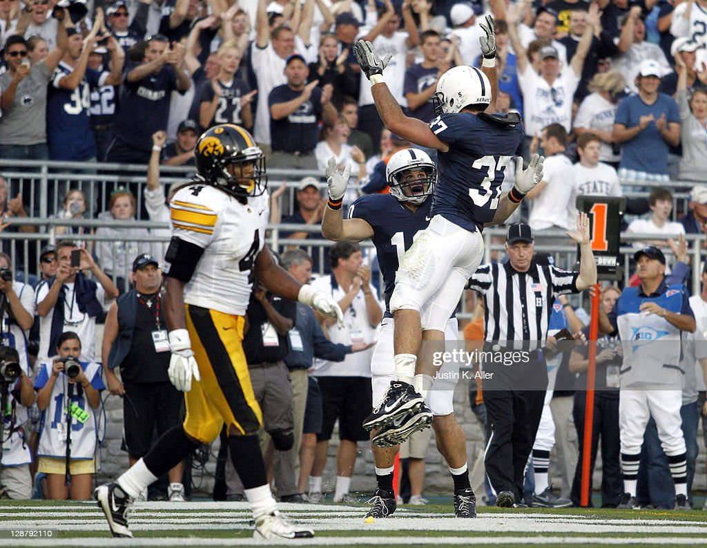 Kevin Haplea #10 of the Penn State Nittany Lions celebrates his forth quarter touchdown with Joe Suhey #37 against the Iowa Hawkeyes during the game on October 8, 2011 at Beaver Stadium in State College, Pennsylvania. The Lions defeated the Hawkeyes 13-3.