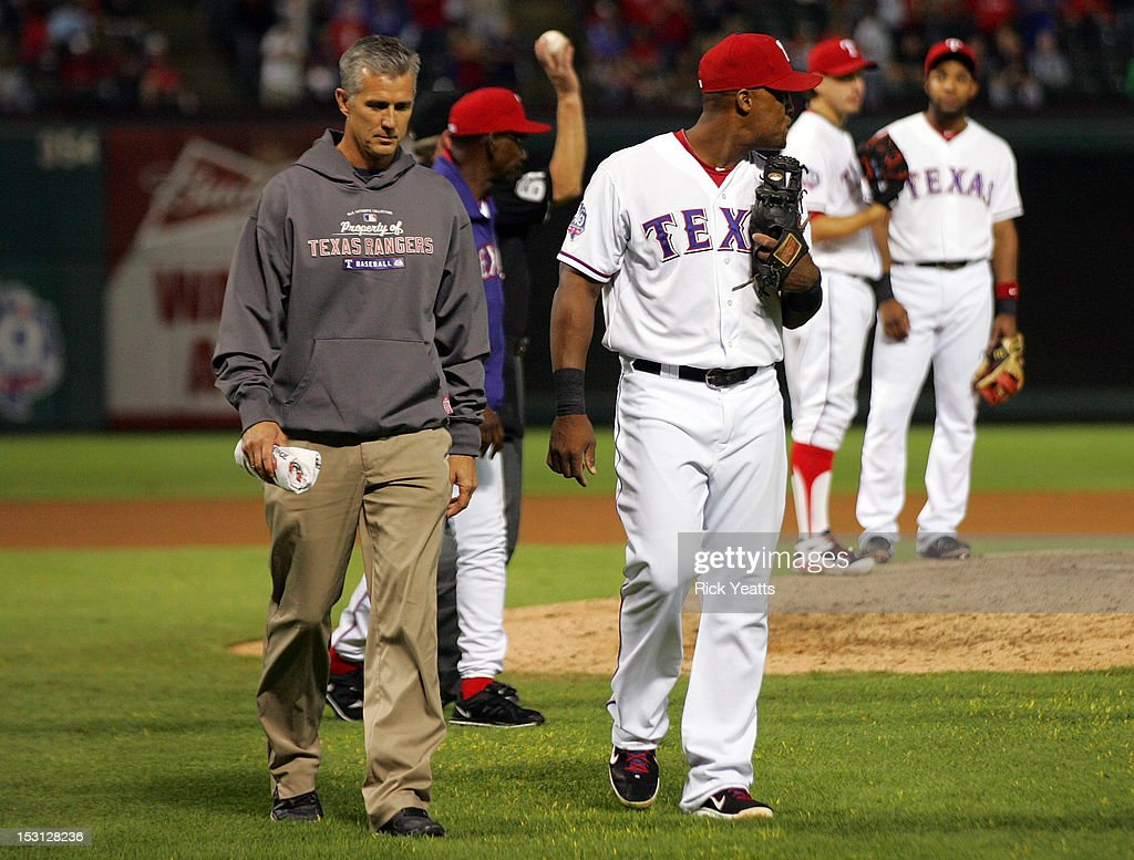 Kevin Harmon trainer of the Texas Rangers leaves the field with <a gi-track='captionPersonalityLinkClicked' href=/galleries/search?phrase=Adrian+Beltre&family=editorial&specificpeople=202631 ng-click='$event.stopPropagation()'>Adrian Beltre</a> #29 due to an injury in game two of the double header against the Los Angeles Angels of Anaheim at Rangers Ballpark in Arlington on September 30, 2012 in Arlington, Texas.