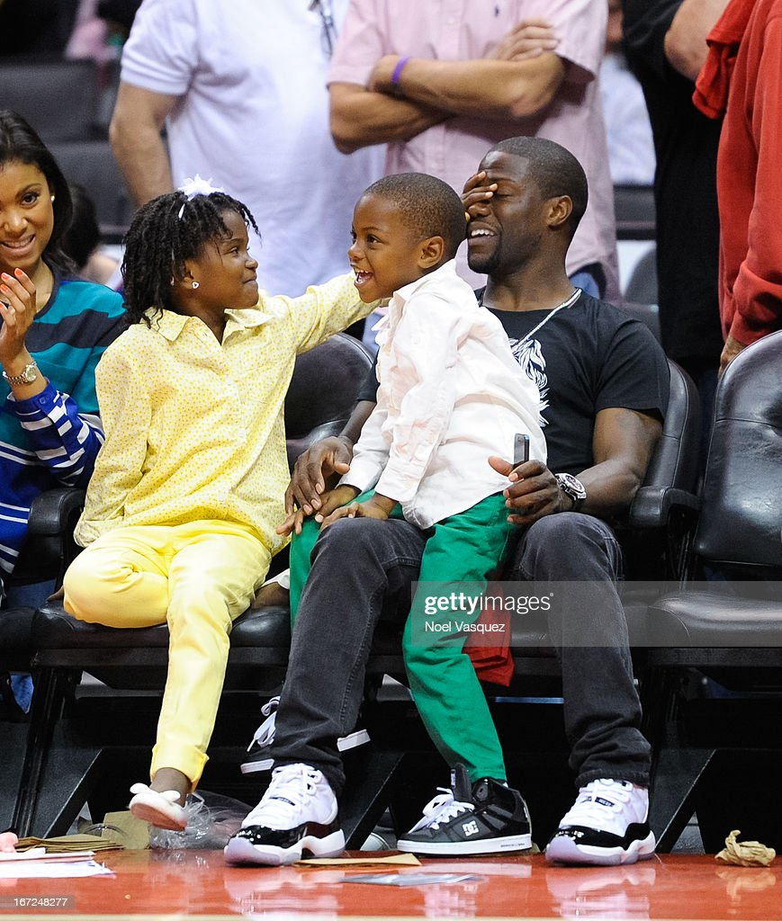 <a gi-track='captionPersonalityLinkClicked' href=/galleries/search?phrase=Kevin+Hart+-+Actor&family=editorial&specificpeople=4538838 ng-click='$event.stopPropagation()'>Kevin Hart</a> and his children Heaven (L) and Hendrix (R) attend a playoff basketball game between the Memphis Grizzlies and the Los Angeles Clippers at Staples Center on April 22, 2013 in Los Angeles, California.