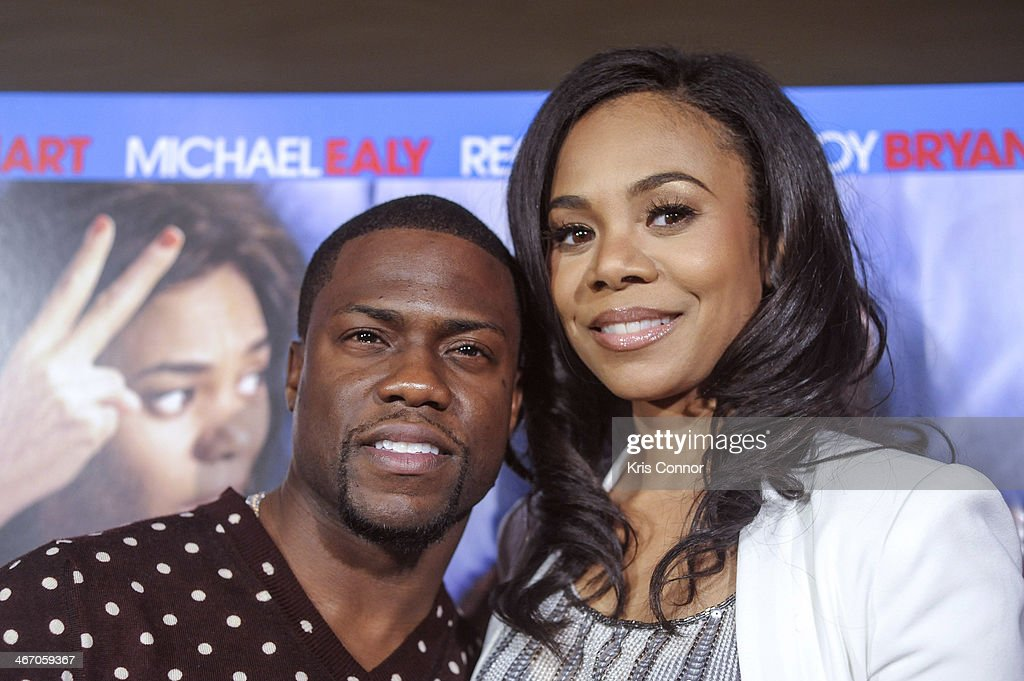 Kevin Hart and Regina Hart walk the red carpet and speak with members of the press during the Washington DC screening of 'About Last Night' at AMC Mazza Gallerie 14 on February 5, 2014 in Washington, DC.