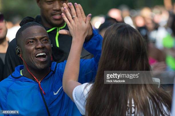 TORONTO ONTARIO AUGUST 2 2015 Kevin Hart greets runners finishing the run with high fives American comedian and actor Kevin Hart in Toronto to...
