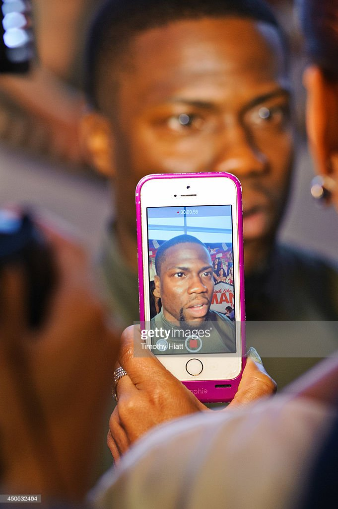 Kevin Hart interacts with fans and the media at a screening of 'Think Like A Man Too' at the Showplace Icon Theater on June 12, 2014 in Chicago, Illinois.