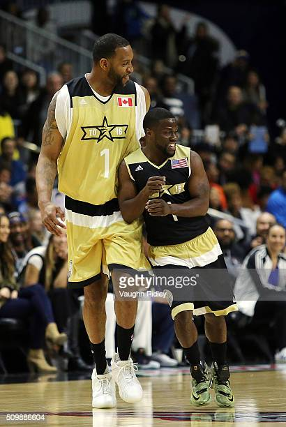 Kevin Hart of Team USA and Tracy McGrady of Team Canada battle for space during the NBA AllStar Celebrity Game at the Ricoh Coliseum on February 12...