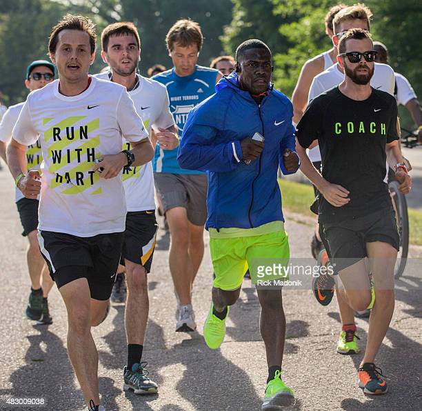 TORONTO ONTARIO AUGUST 2 2015 Kevin Hart runs near the front of the pack along the sidewalk on the CNE grounds American comedian and actor Kevin Hart...