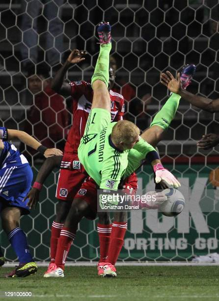 Kevin Hartman of FC Dallas flips over Patrick Nyarko of thye Chicago Fire while making a save during an MLS match at Toyota Park on October 12 2011...